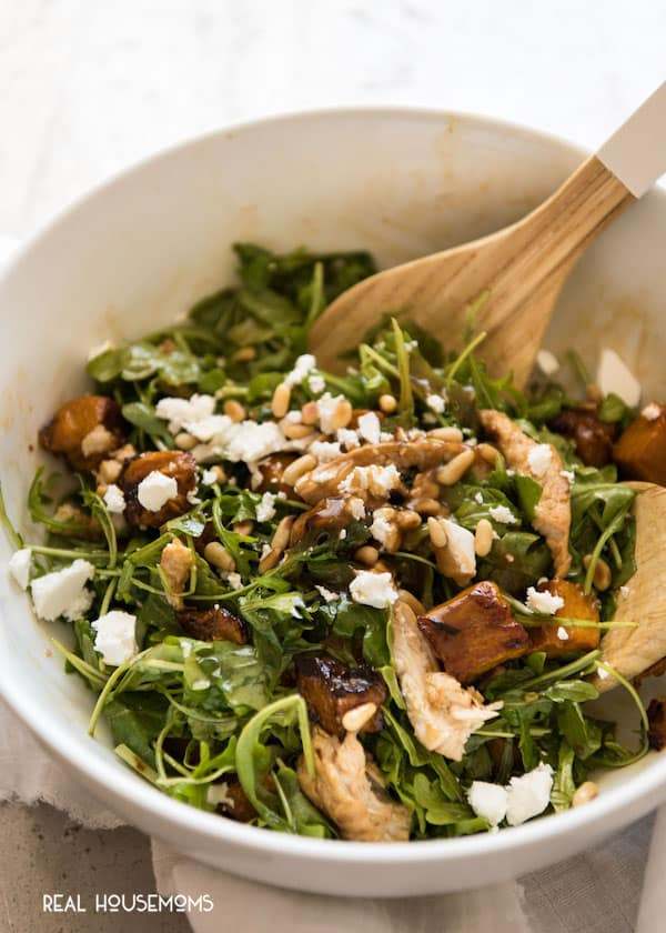 Balsamic Pumpkin & Chicken Salad assembled in a salad bowl with serving spoons