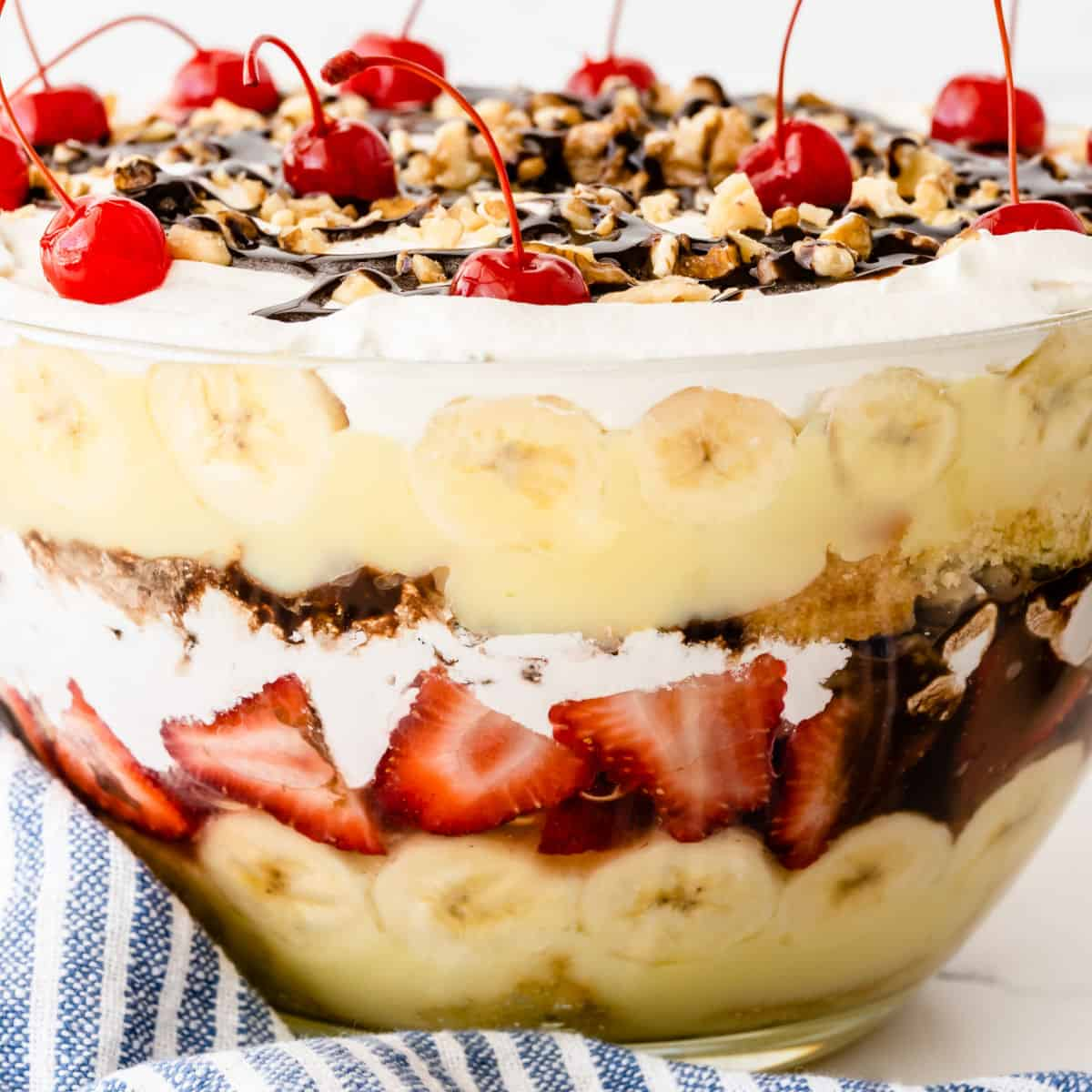 square image of side view of banana split trifle to show all the layers