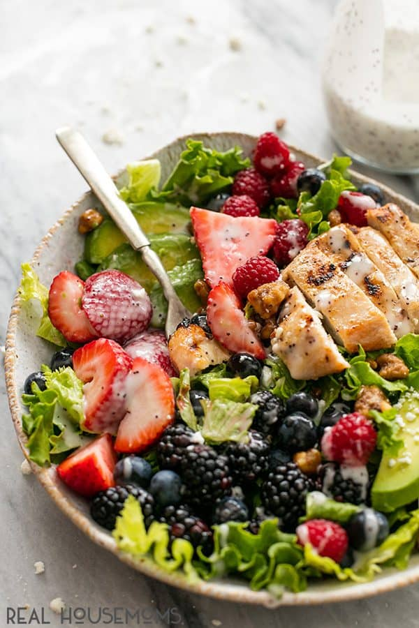 Easy and healthy Berry Avocado Grilled Chicken Salad is a cinch to whip up in just 30 minutes with incredible flavors and textures. The poppyseed dressing brings all of those flavors together in this yummy salad!