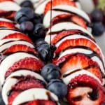 Red, white, and blue never tasted so good! The juicy berries, fresh mozzarella cheese, and balsamic reduction's sweet, syrupy goodness in this BERRY CAPRESE will have everyone coming back for more!