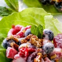 BERRY SALAD FRUIT LETTUCE WRAPS are one of the BEST ways to eat fruit salad! This dish tastes indulgently gourmet but takes minutes to whip up!