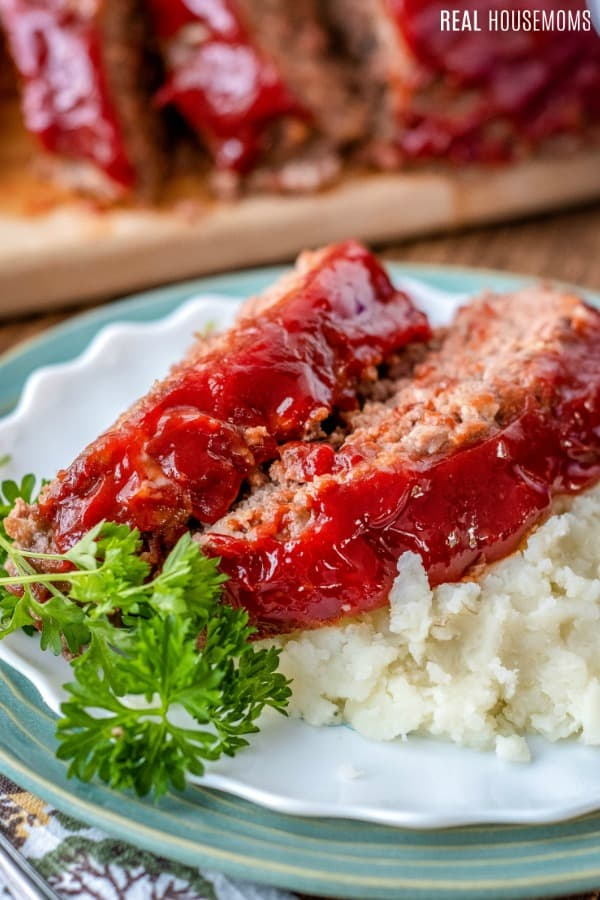 meatloaf slices on a plate with mashed potatoes