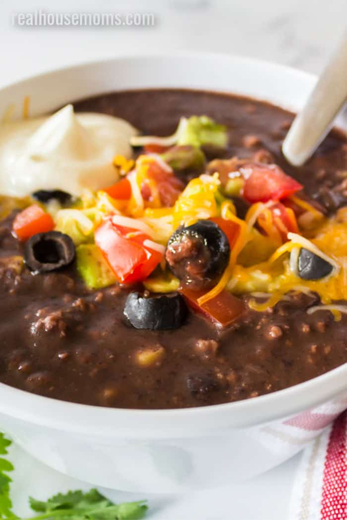 black bean soup in a bowl with a spoon