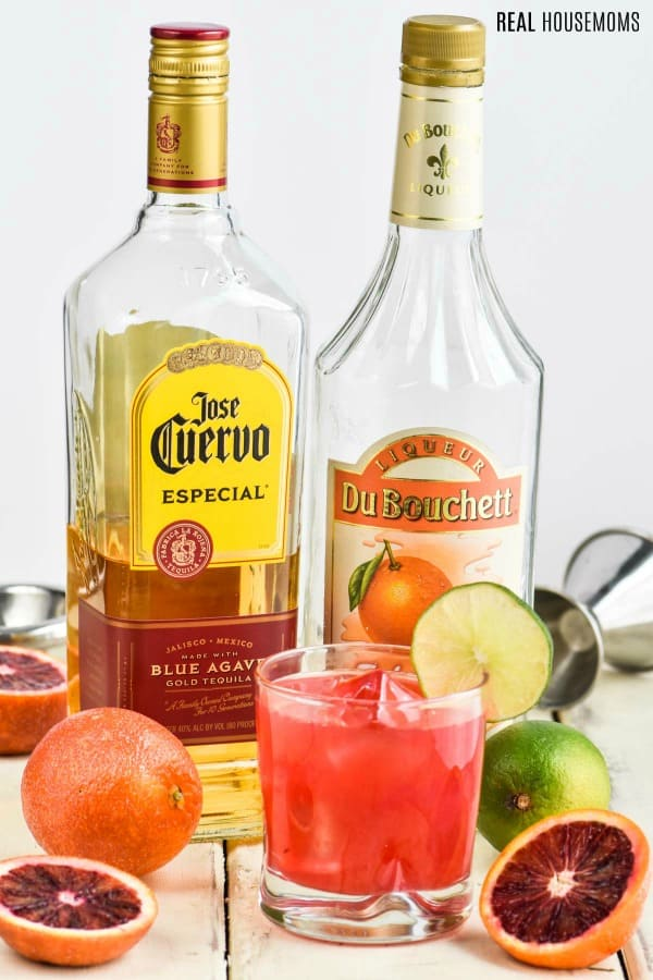 blood orange margarita with tequila and triple sec bottles
