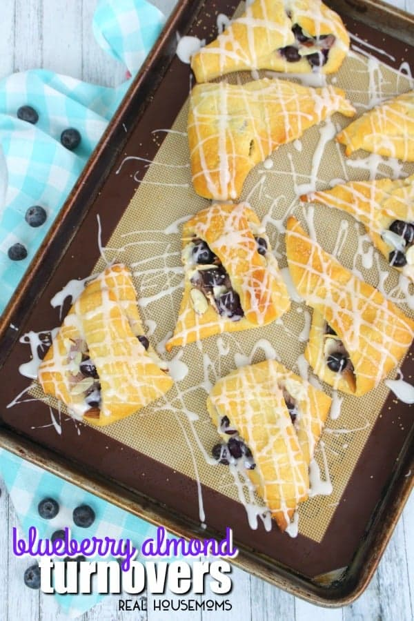 If breakfast pastries are your thing then these Blueberry Almond Turnovers are for you! This delicious turnover recipe is made with refrigerated crescent roll dough a super easy breakfast treat!