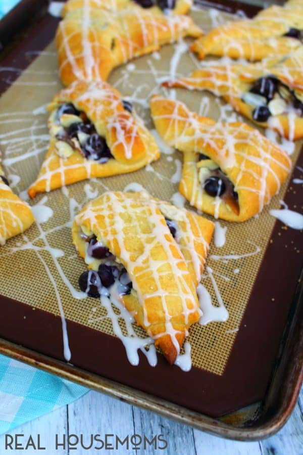 Finished Blueberry Almond Turnovers with glaze drizzled over the tops.