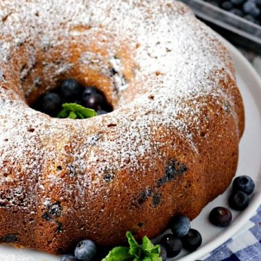 BLUEBERRY BUTTERMILK COFFEE CAKE is a delightfully moist cake bursting with fresh blueberries and a cinnamon pecan filling! You'll want to bake one up immediately to go with your next cup of coffee!