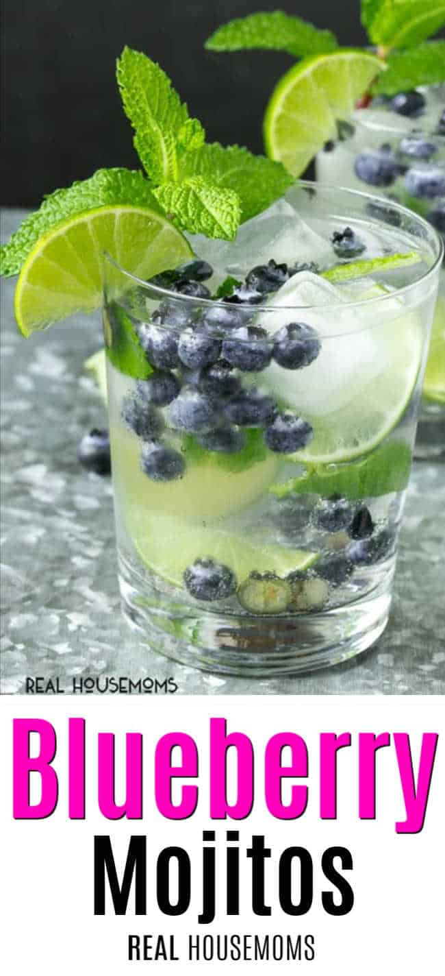 Glass filled with blueberries mint and lime