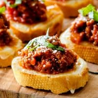 Bolognese Bruschetta is the hearty, comforting winter version of traditional bruschetta that makes an ideal appetizer that will be the hit of every party!