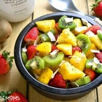"""This BOOZY TROPICAL FRUIT SALAD is the perfect addition to your spring or summer menu! Loaded with fresh tropical fruit and swimming in a boozy coconut-lime """"dressing"""", it's sure to become your favorite new way to eat fruit!"""
