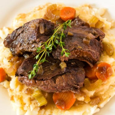 Braised Short Ribs are slow cooked in red wine until fork tender for a cozy and elegant dinner. They make great leftovers too!