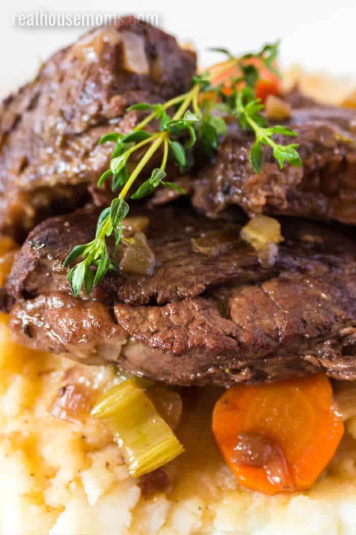 close up of short ribs over mashed potatoes