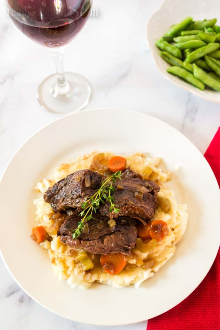 beef short ribs over potatoes with red wine