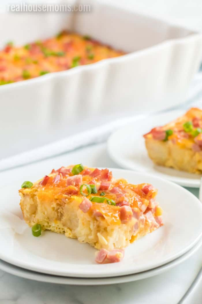 slice of breakfast casserole with ham on a plate
