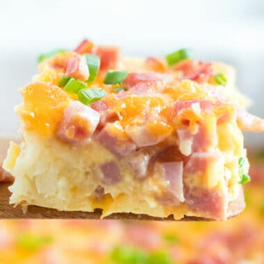 Easy Breakfast Casserole with Ham is cheesy, gooey, and delicious (BONUS - it has tater tots). Your family will be scraping their plates & begging for more!