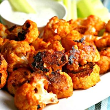 Buffalo Cauliflower Bites are a spicy appetizer that's perfect for game day! This secretly healthy recipe is so good, no one will miss chicken wings!