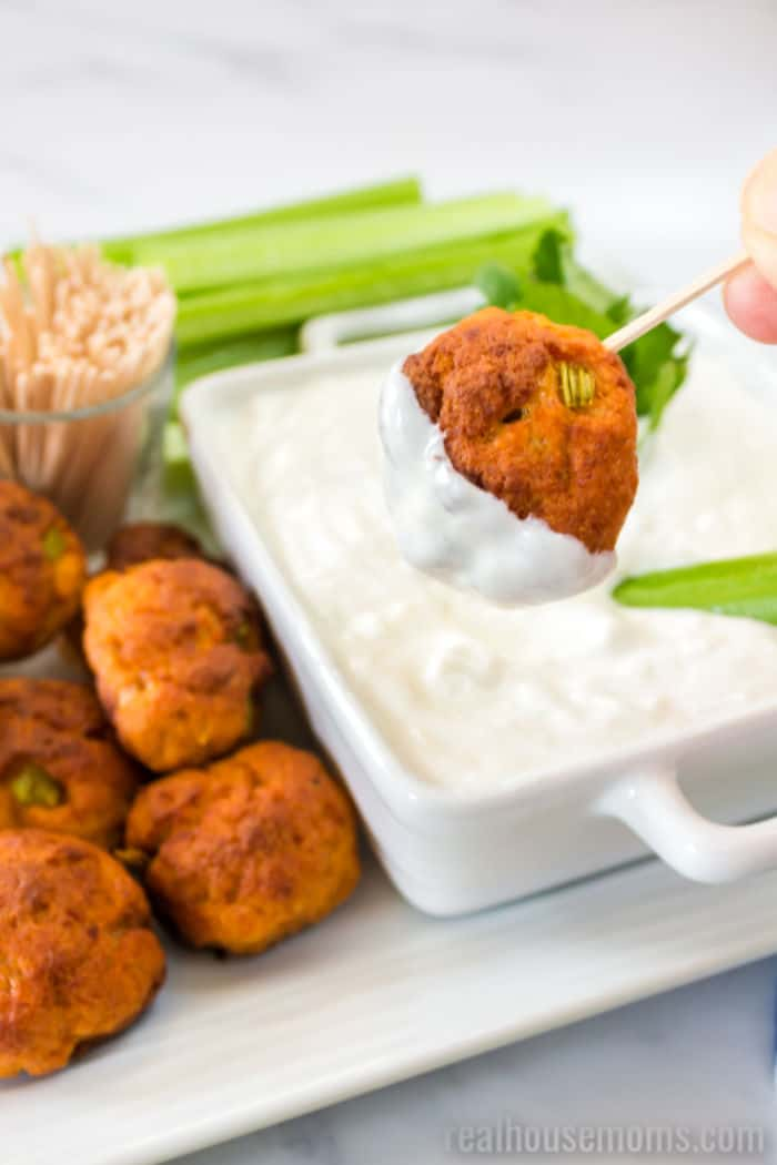 buffalo chicken meatball dipped in blue cheese sauce