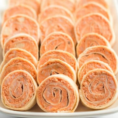 "Buffalo Chicken Pinwheels are bursting with spicy buffalo flavor and savory blue cheese. They are the ULTIMATE football food - they'll disappear faster than you can say ""touchdown!"""