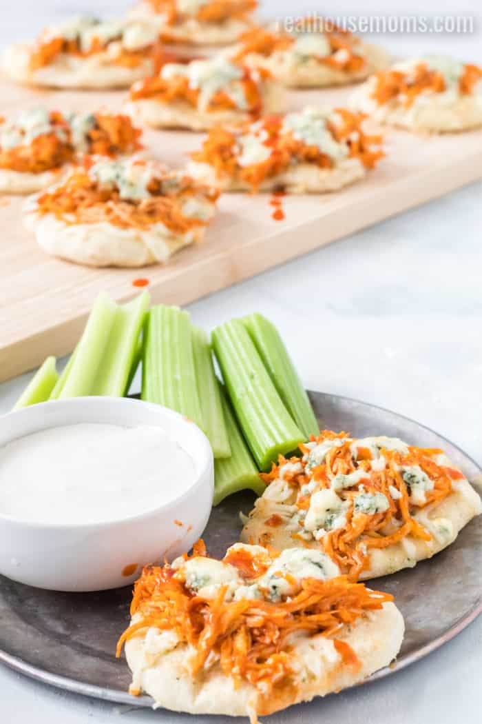 buffalo chicken pizza bites on a plate with ranch dressing and celery