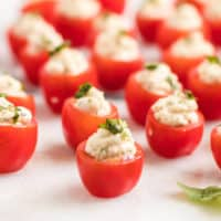Take these Caprese Tomato Bites to your next potluck & watch them disappear! Juicy tomatoes filled with herbed mozzarella makes it hard to stop at just one!