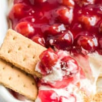 Cherry Cheesecake Dip is the most divine, easy to make dish! It's the ultimate 5-ingredient no bake dessert or appetizer for any party!