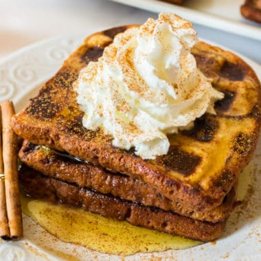 Cinnamon French Toast Waffles are soft and creamy on the inside, and crisp and golden on the outside. This breakfast hybrid is out-of-this-world good!!