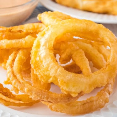 One of my favorite things to serve up alongside hamburgers and hot dogs is a pile of Crispy Onion Rings! Crunchy and sweet, they're delicious dipped in fry sauce!