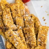 one pic of a group of crunch French toast stick on a white plate