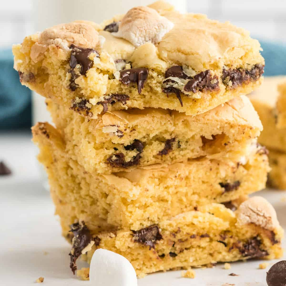 square iamge of cake mix cookie bars stacked up