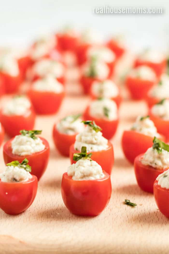cherry tomato halves with garlic basil mozzarella filling