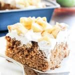 """""""Fall"""" in love with this easy spiced CARAMEL APPLE POKE CAKE drizzled with caramel!"""