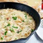 This CARAMELIZED ONION AND BACON SKILLET DIP is an ooey, gooey appetizer no one can resist!