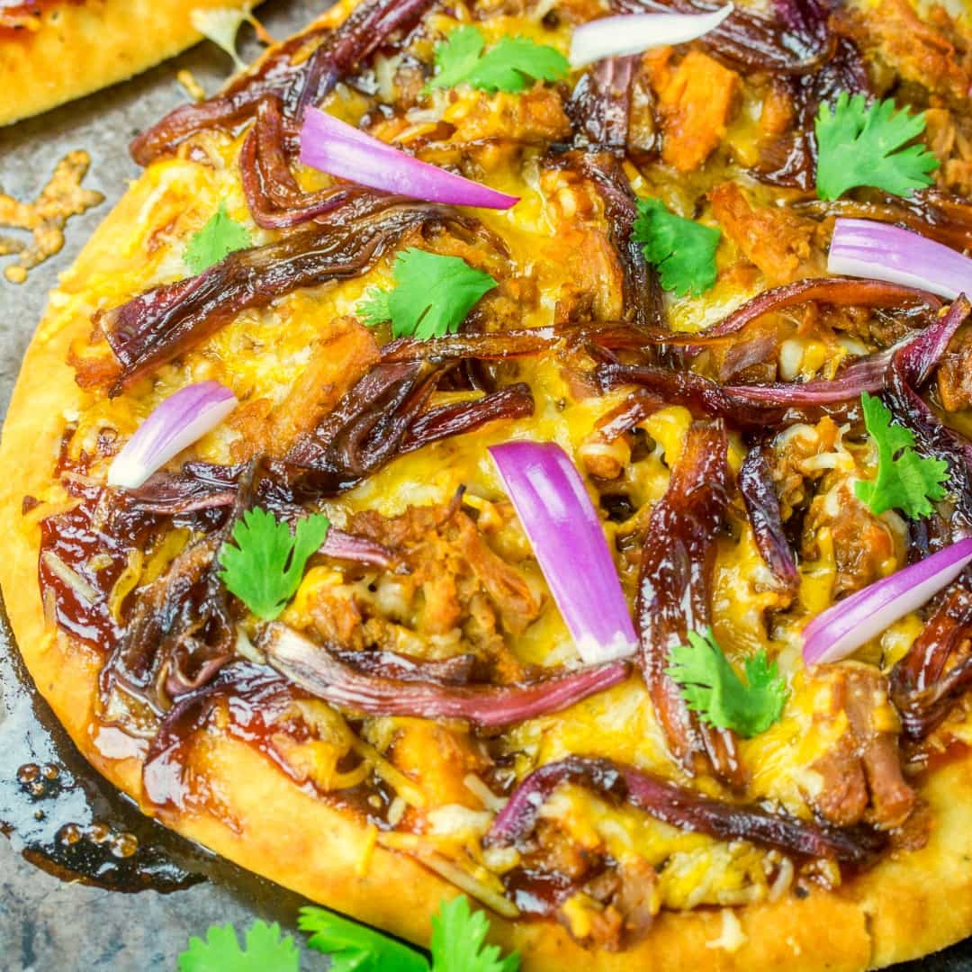 This Caramelized Onion and BBQ Pork Flatbread is a fun and easy weeknight dinner that the whole family will be ranting and raving about!