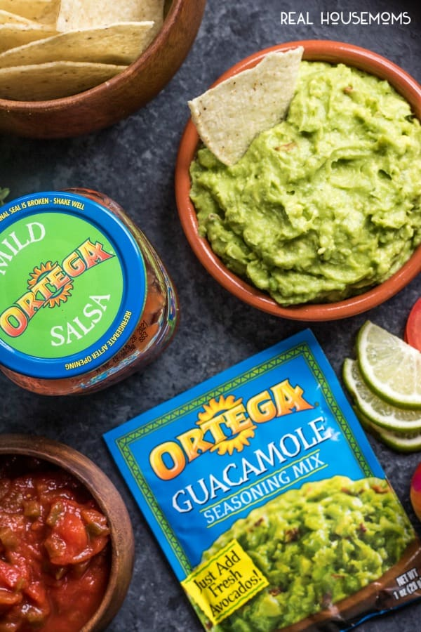 Ortega guacamole in a serving bowl along side salsa and tortilla chips