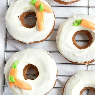 These fluffy BAKED CARROT CAKE DONUTS are glazed with a simple cream cheese frosting for a new twist on a classic Easter dessert!