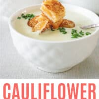 white bowl filled with cauliflower bisque with recipe name at bottom