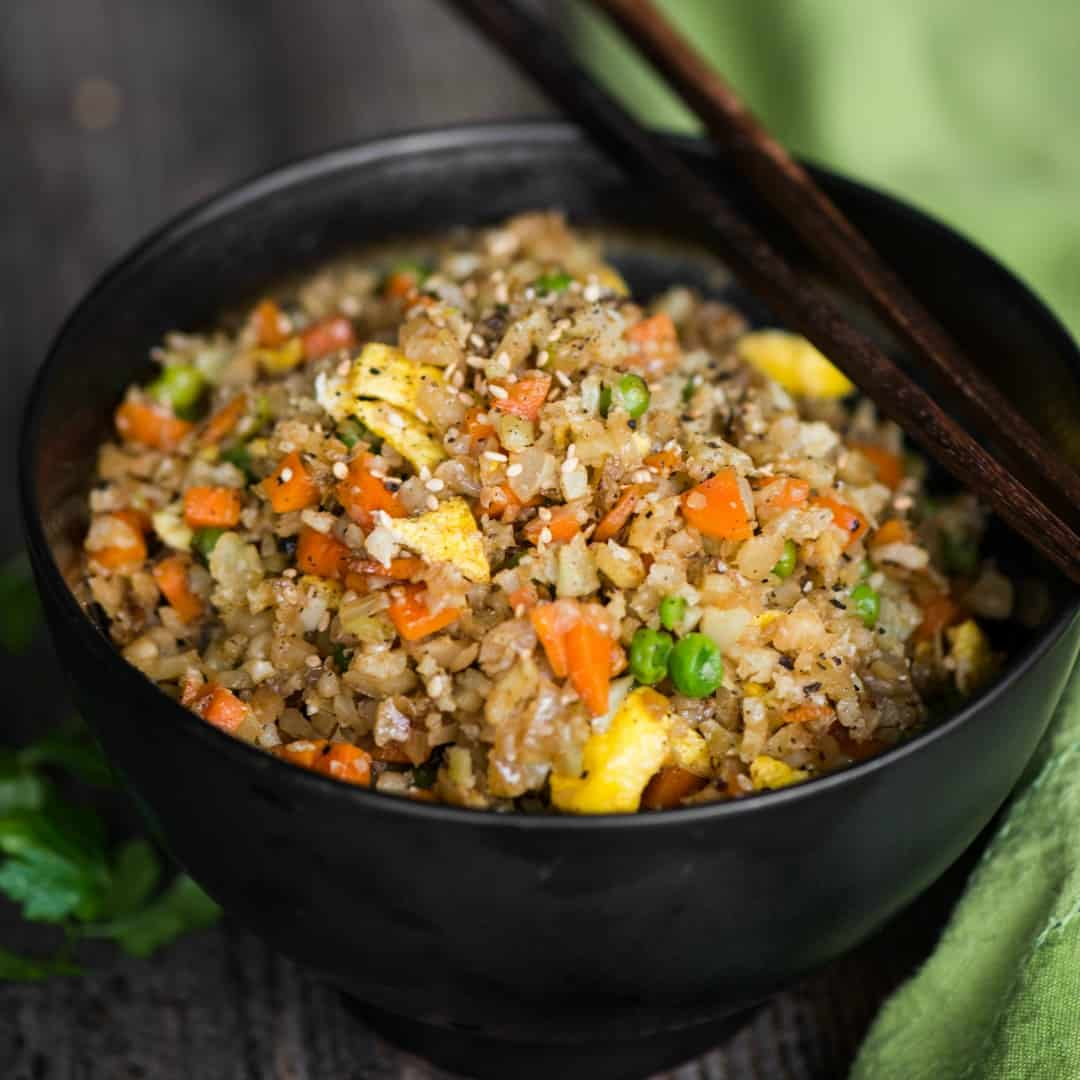 Cauliflower Fried Rice is an easy to make a tasty, low carb meal packed with vitamins and flavor! This rice is so good you won't even think you're eating healthy!
