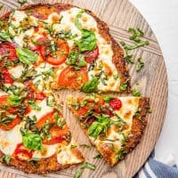 A healthier alternative to your pizza cravings - Cauliflower Pizza Crust is easy, flavor-packed, more filling, and can be frozen for later too!