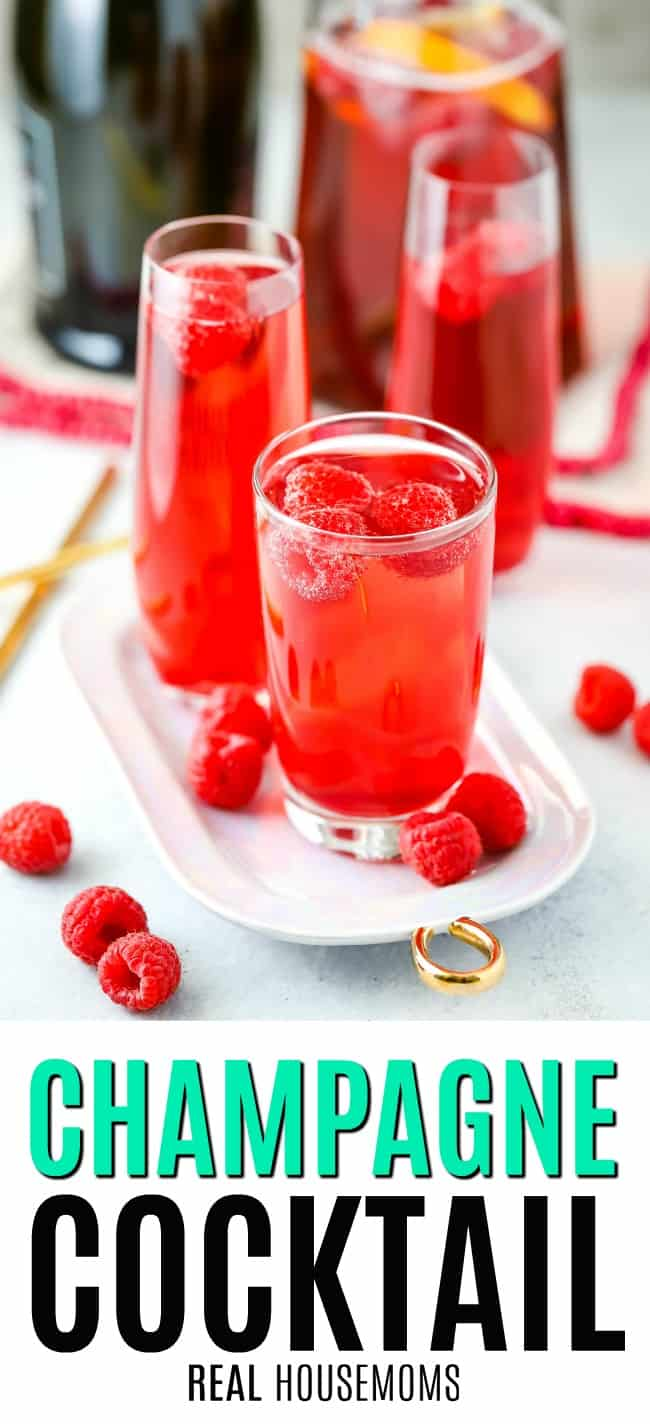 raspberry champagne cocktail in a cocktail glass with raspberries