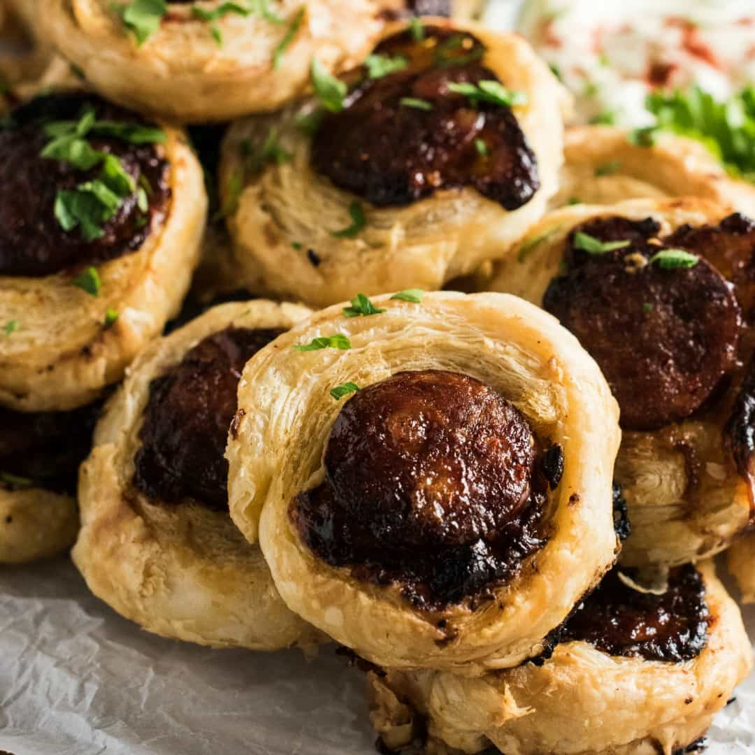 These delicious Chorizo Pinwheel Bites are stuffed with cheddar and drizzled with honey then baked until the pastry is puffed and golden. They can be made a day ahead for a quick and easy appetizer!