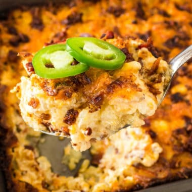 Cheesy Bacon & Jalapeno Hash Brown Casserole is a spicy and rich side dish! It pairs perfectly with comfort food like a ham dinner, pork chops or pot roast!