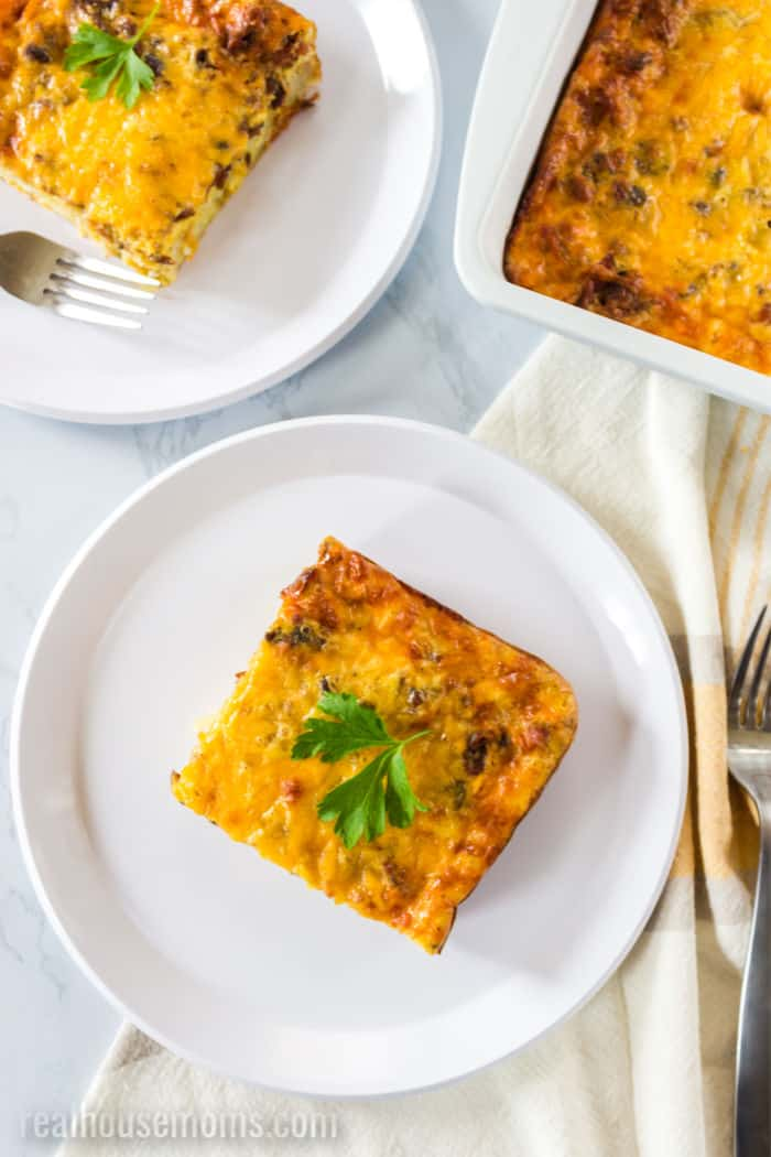 slices of breakfast casserole topped with parsley