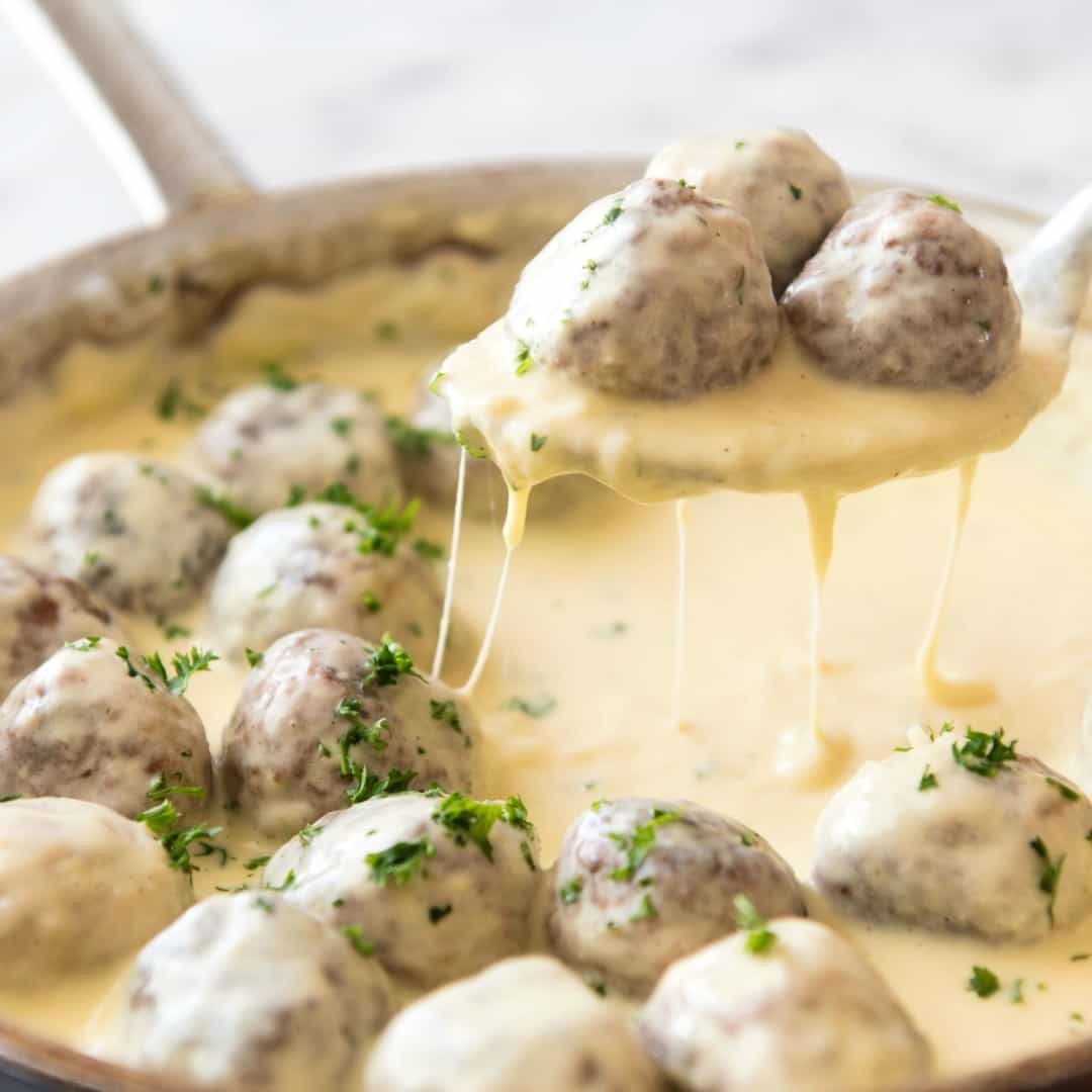 How do you make meatballs even better? By smothering them in a gorgeous cheese sauce! I think you and these Cheesy Chicken Meatballs are going to be very good friends.