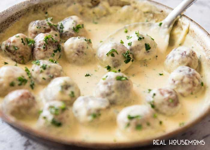 Cheesy Chicken Meatballs recipes, finished in a skillet and sprinkled with parsley