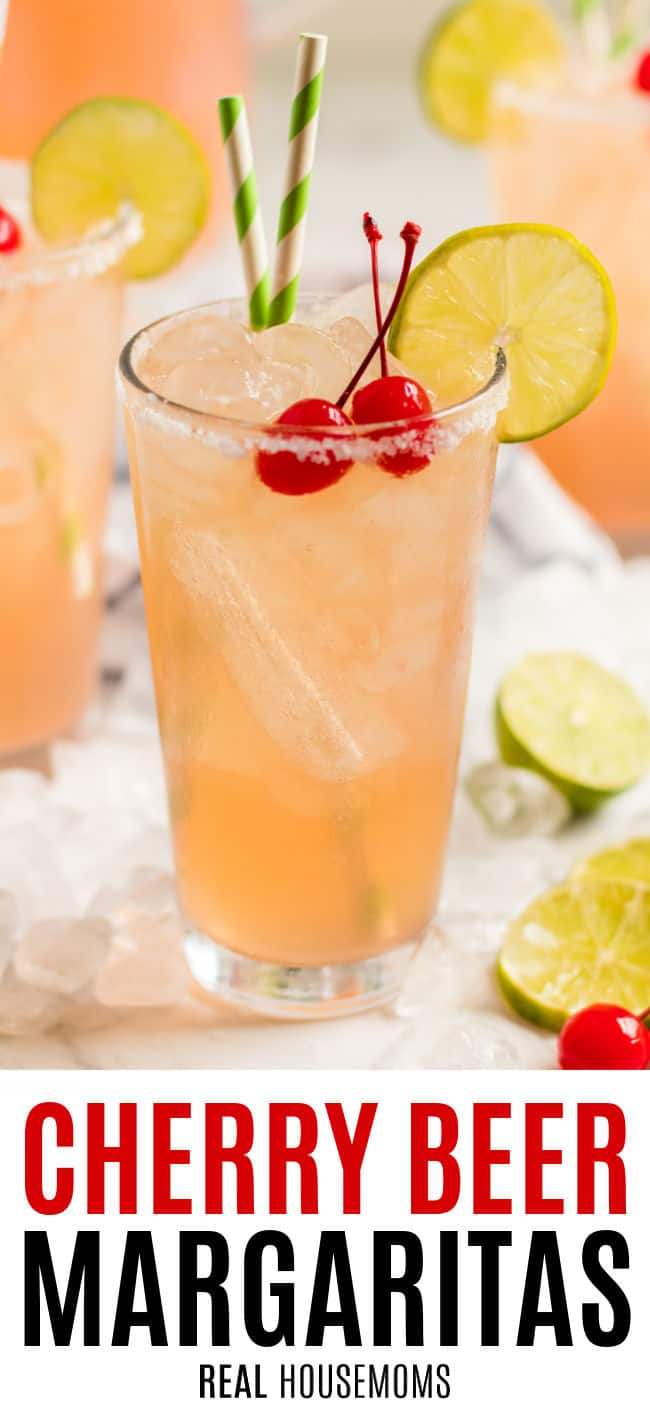 close up of a glass of cherry beer margarita with limes and cherries