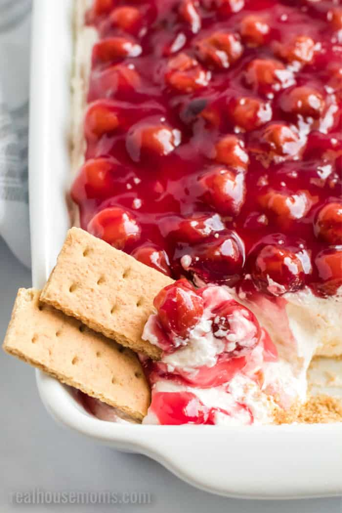 graham crackers with a dish of cherry cheesecake dip