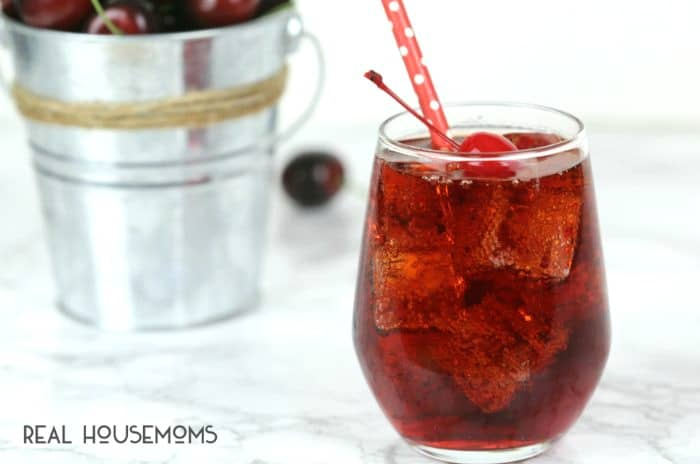This easy CHERRY SPRITZER COCKTAIL is light, sweet and delicious for a summer drink everyone will love!
