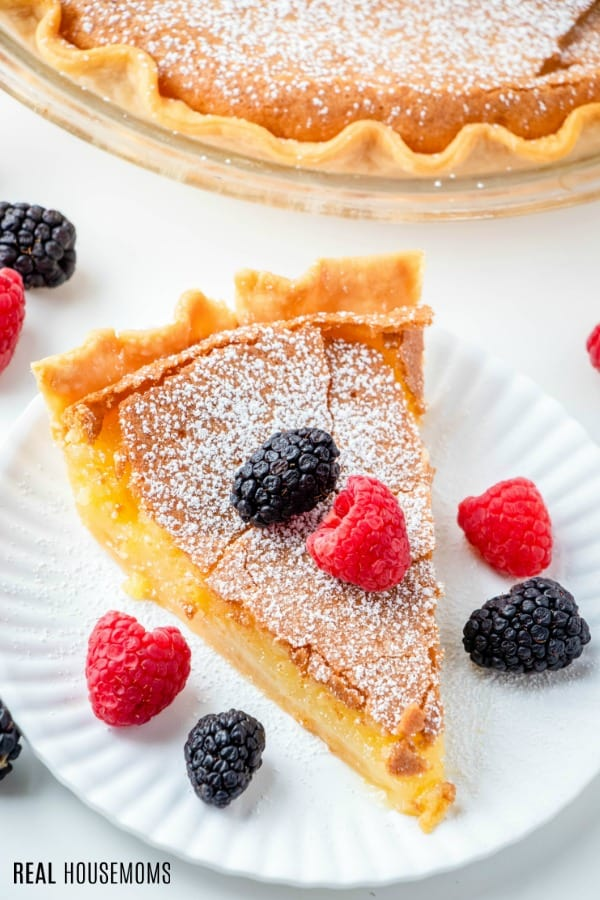 slice of chess pie sprinkled with powdered sugar on a plate