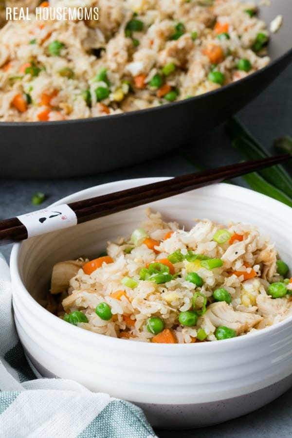 chicken fried rice in a skillet and severed in a bowl