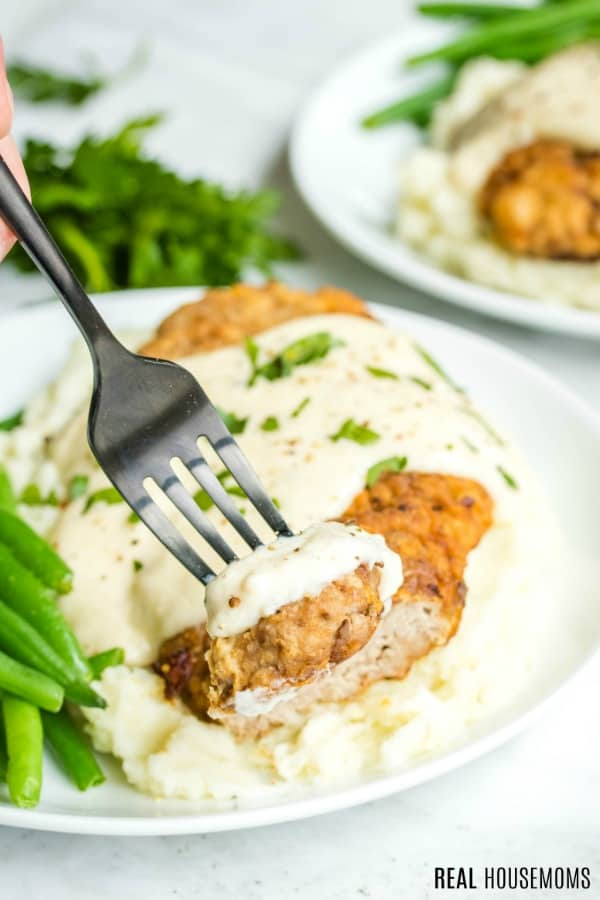 fork with bite of chicken fried steak